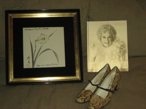 Picture and catalog from the auction along with a pair of Phyllis's own shoes