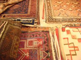 Piles of rugs -- all at 60% off. And no delivery fee!